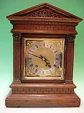 An Oak Mantel Clock. Architectural case. The 8 day