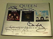 Queen. A Greatest Hits CD album^ signed by the thr