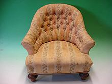 A Victorian Child's Tub Armchair with deep-buttone