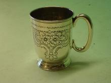 Silver Mug chased with scrolls and foliage. 3? hig