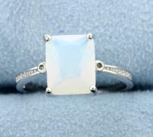 Sterling silver ring with lab Opal & Diamonds
