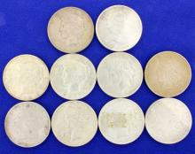 Silver dollars and a Canadian Maple Leaf