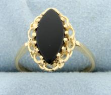 Onyx and gold ring