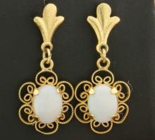 Opal dangle style earrings