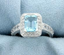 Halo Style Sky Blue Topaz Ring in a Vintage Style Sterling Silver  Mounting