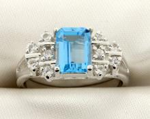 Genuine Blue Topaz and white sapphire ring