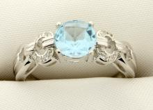 Cartier style ring with genuine Sky Blue gemstones