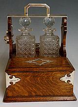 A late Victorian silver mounted oak two bottle tan