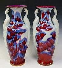 A pair of Jun ware porcelain vases modelled with s