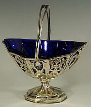 An Edwardian navette shaped pedestal sugar basket