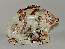 An 18th Century porcelain model of a recumbent Flo