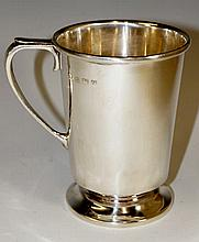A tankard of slightly tapered cylindrical design w