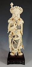 A Chinese carved ivory figure of a warrior, engrav