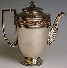 Fabergé - a teapot, the urnular body with hinged s