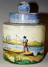 An Italian Faience cylindrical jar and cover the b