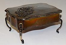 A dressing table box of serpentine outline the hin