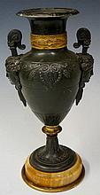 A bronzed spelter classical urn the body cast with