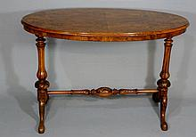 A Victorian oval walnut centre table the figured q