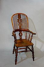 A 19th Century yew-wood high back broad arm Windso