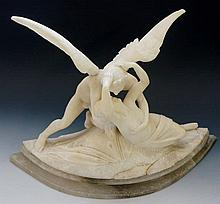 A white marble figure group of an angel holding li
