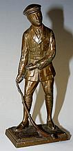 A French bronzed spelter figure of a golfer, 13.5c