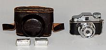 A Crystar miniature camera in fitted leather case