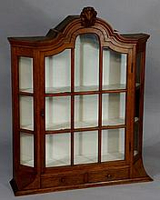 A Dutch oak display cabinet with arched top centre