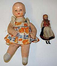 A clockwork shaking doll with papier maché head, c