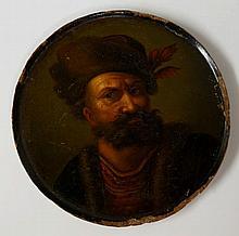 A circular papier maché snuff box lid, decorated w
