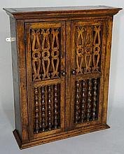 An oak spice cupboard in late 17th Century style t