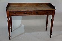 A George IV mahogany two drawer wash stand with th