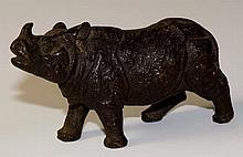 A miniature bronze figure of a black rhino, 8.5cm