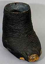 An elephant's foot with applied decoration, 38cm h