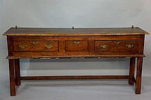 A walnut veneered dresser base in Georgian style t