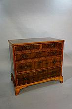 An oyster veneered walnut chest in William and Mar