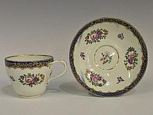 A Dr Wall Worcester teacup and saucer polychrome