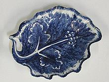 A Bow porcelain leaf moulded dish painted in under