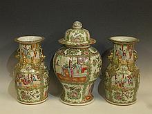 A garniture of three Cantonese famille vert vases