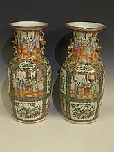 A pair of Cantonese famille rose vases with dog of