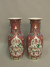 A pair of Chinese famille rose rouleau vases