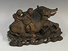 A Chinese hardwood carved figure of an oxen with