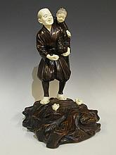 A fine Japanese bronze and ivory figure of an