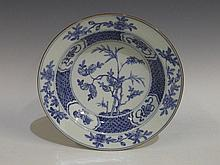 A Chinese export porcelain circular plate painted