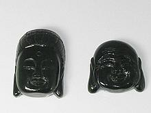 Two jade Buddha heads, carved, the reverses