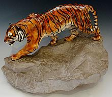 A Royal Doulton porcelain figure - Tiger On The Rock (Prestige) designed by