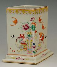 A Chinese famille rose lozenge shaped brush pot, the body painted with flow