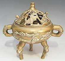 A Chinese brass two handled incense burner of compressed cauldron form, thr
