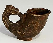 A Chinese bronze vessel of cornucopia design with beast terminal, the body