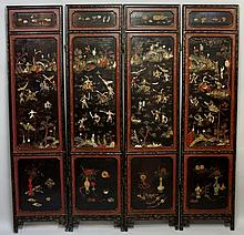 A 19th Century Chinese lacquer four fold screen, each leaf with large panel