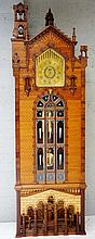 A longcase clock of architectural proportions, the brass dial pierced to th